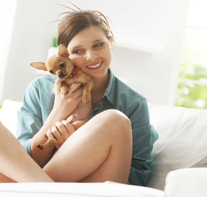 woman sitting holding fawn chi