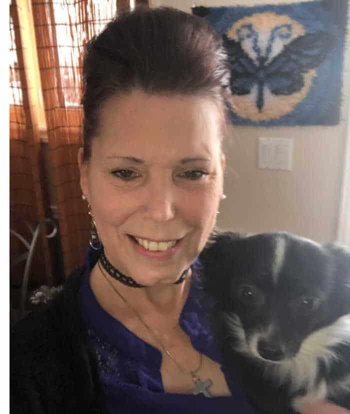 woman holding a chihuahua