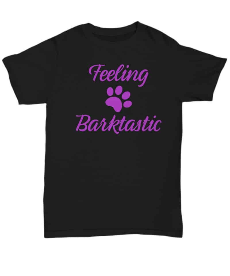 Tshirt has a paw print and says Feeling Barktastic