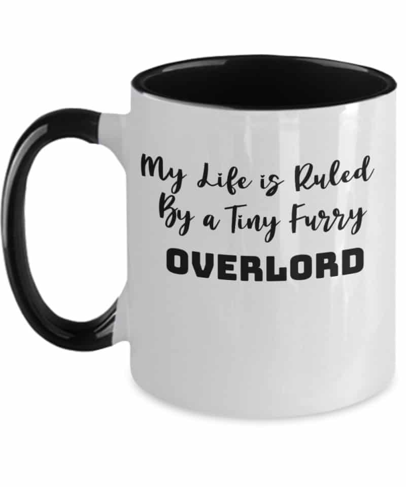 White mug with black handle says My Life is Ruled by a Tiny Furry Overlord